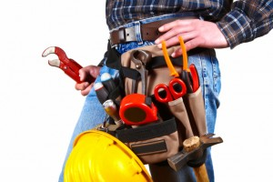 Plumber with tools on his belt