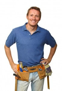 Plumber with tools is smiling